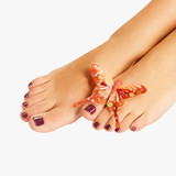 female feet with beautiful pedicure after spa procedure