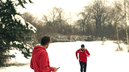Runners while training in a wintry wood, slow motion shot at 240