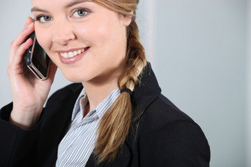 Young businesswoman smiling on the phone.