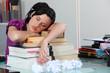 Woman sleeping on her books