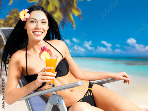 Happy woman on vacation enjoying at beach