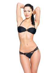 Slim body of young  woman in black bikini