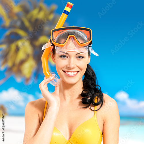 Portrait of happy beautiful woman at beach