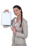 Woman pointing to blank clip-board