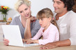 Parents with daughter and computer