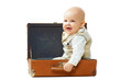 Cute baby in vintage suitcase