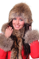 Portrait of a beautiful happy woman wearing fur