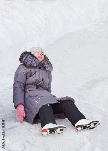 Woman has fallen on the ice rink
