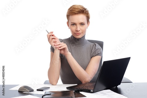 Beautiful businesswoman sitting at desk
