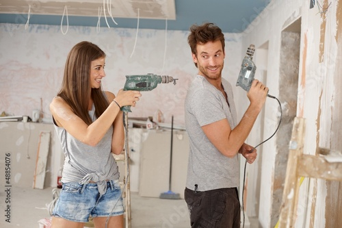 Happy couple having fun at renovation