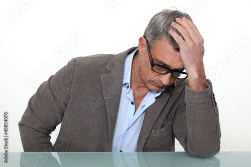 Desperate man sitting at a desk