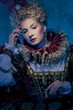 Pensive queen in royal dress