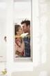 Kissing couple at home renovation