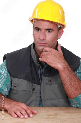 Pensive manual worker