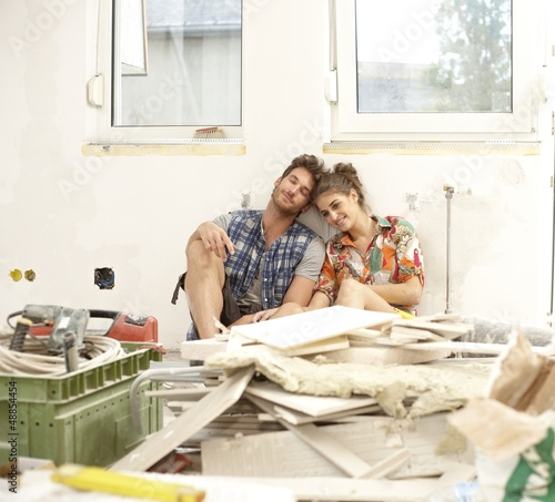Young couple exhausted in DIY