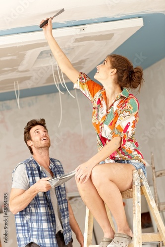 Young couple renovating home