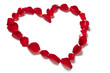 Red rose petals in heart shape