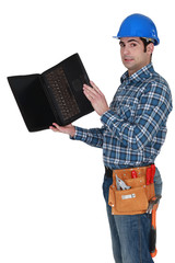Carpenter stood with laptop