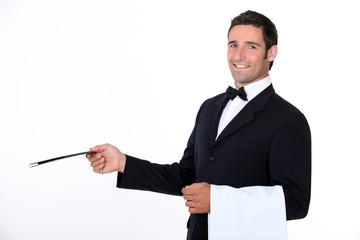 A waiter of a fancy restaurant.