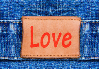 Closeup jeans leather label with text Love