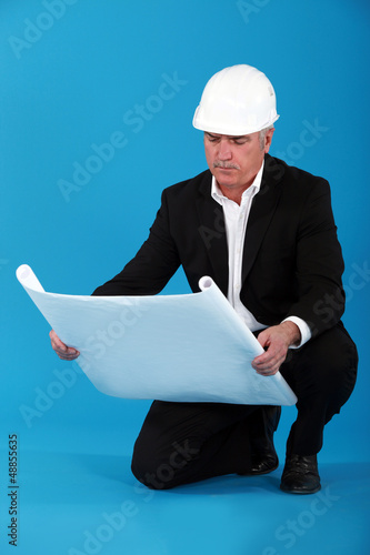 Senior man kneeling