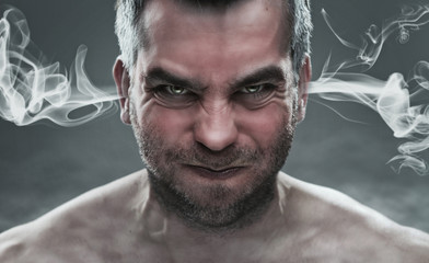 Close up of angry man with steam coming out from his ears