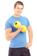 A young guy lifting a dumbbell