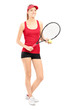 Full length portrait of a smiling female holding a tennis racket