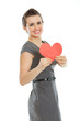 Smiling young woman showing heart shaped postcard