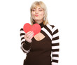 Happy mature woman enjoying heart shaped postcard