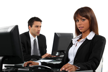 Business partners working on computers