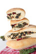 Stack of pies with cheese, beet tops and chard