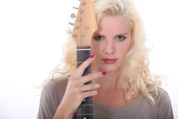 Woman holding an electric guitar