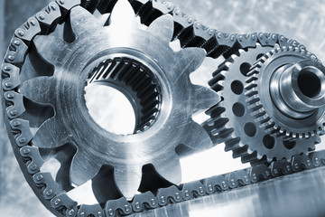 gears, chains and pinions, engineering concept in blue