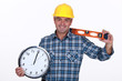 carpenter all smiles holding ruler and clock