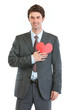 Modern man in business suit with heart shaped postcard
