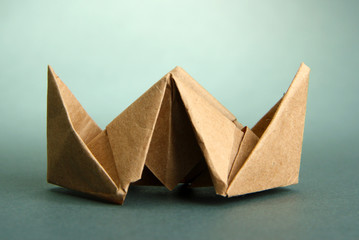 Origami steamer on grey background