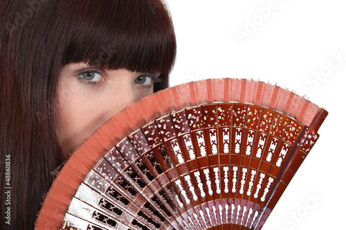 Woman holding hand fan