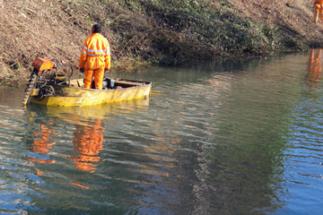 boat with a warden with the Orange jumpsuit during the crossing