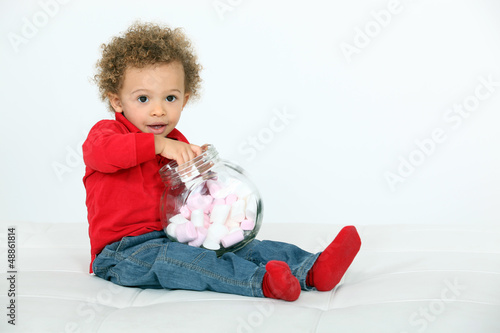 Baby eating sweets