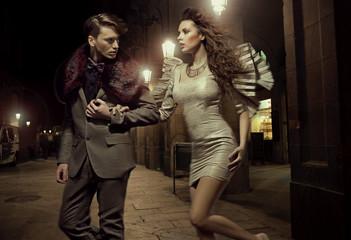 Fashionable couple at nightly walk