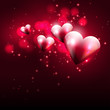 Flying hearts on dark background