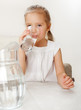 Child with glass pitcher water