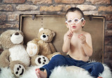 Small cute kid with teddybears