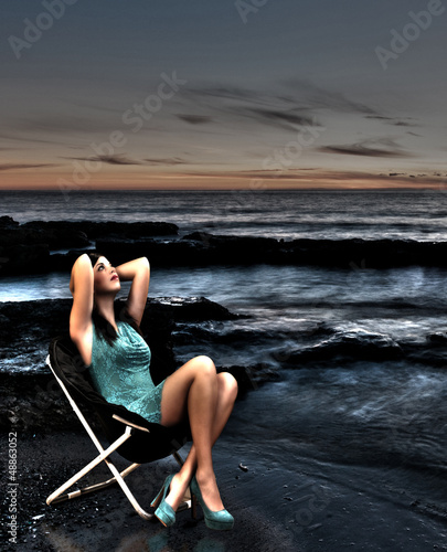 girl sitting by the sea