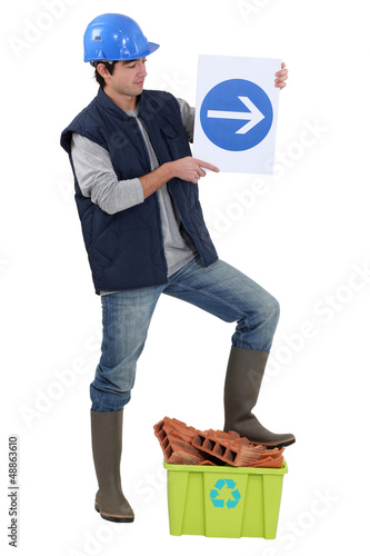 Labourer holding a traffic sign