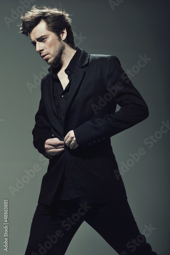 Young confident man wearing suit