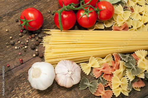 spaghetti, farfalle , cherry tomatoes and garlic
