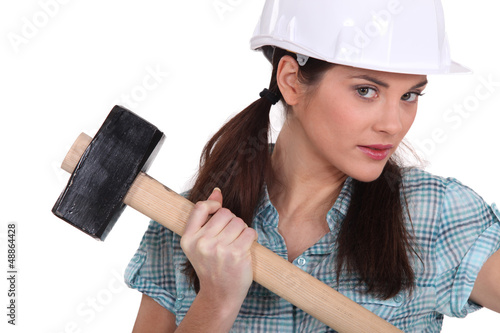 Female construction worker holding a mallet
