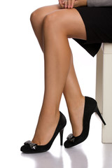 Legs of a business woman sitting and waiting